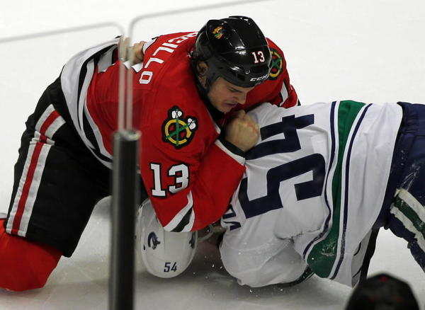 Chicago Blackhawks wingman Daniel Carcillo mixes it up with Vancouver Canucks' Aaron Volpatti in 2011. Carcillo is paying $640,000 for a Lincoln Park penthouse. Full story