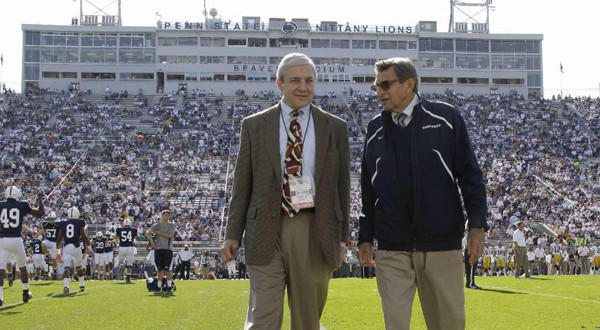 Penn State President Graham Spanier, left, and head football coach Joe Paterno chat before a game against Iowa in State College, Pa., before the child abuse scandal cost them their positions.