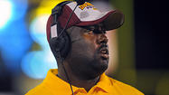 "Dunbar football coach Lawrence Smith has been named the Ravens' High School Coach of the Week after the No. 8 Poets christened their new William F. ""Sugar"" Cain Field with a 64-0 win over Carver on Friday night."