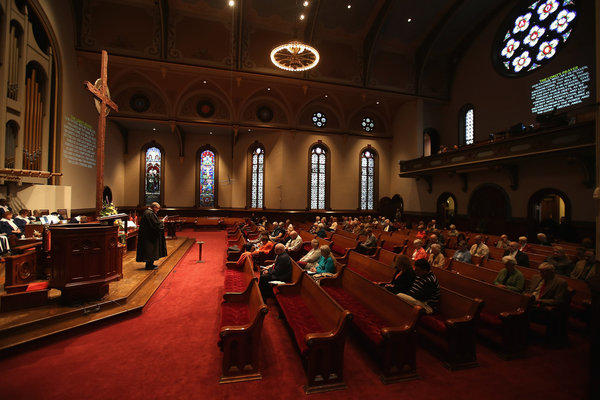Rev. Rusty Cowden leads a Sunday service at the First Presbyterian Church in Warren, Ohio.