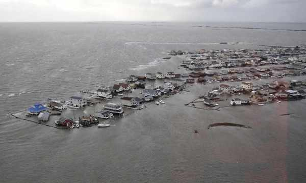 "Homes are flooded after Hurricane Sandy made landfall on the southern New Jersey coastline in this U.S. Coast Guard handout photo in Tuckerton, New Jersey on October 30, 2012. In the storm's wake, President Obama issued federal emergency decrees for New York and New Jersey, declaring that ""major disasters"" existed in both states. One disaster-forecasting company predicted economic losses could ultimately reach $20 billion (12.4 billion pounds), only half insured."