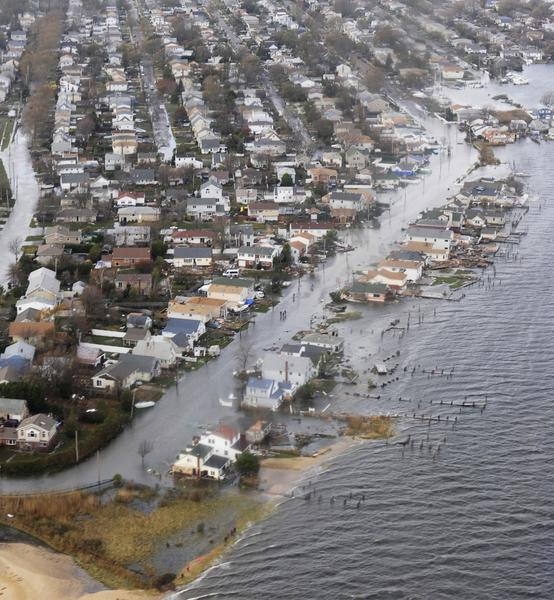 Flooding from Hurricane Sandy can be seen in this aerial U.S. Coast Guard handout photo showing Long Island, New York on October 30, 2012. Millions of people across the U.S. Northeast stricken by massive storm Sandy will attempt to resume normal lives on Wednesday as companies, markets and airports reopen, despite grim projections of power and mass transit outages lasting several more days.