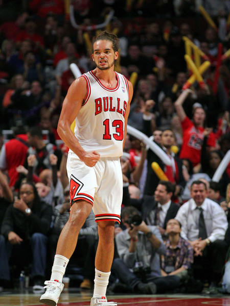 Bulls center Joakim Noah celebrates a score during the second half against the Sacramento Kings at the United Center. The Bulls won 93-87 and Noah recorded a double-double.