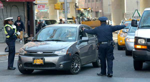 Police officers manage bridge traffic in Brooklyn after super storm Sandy.