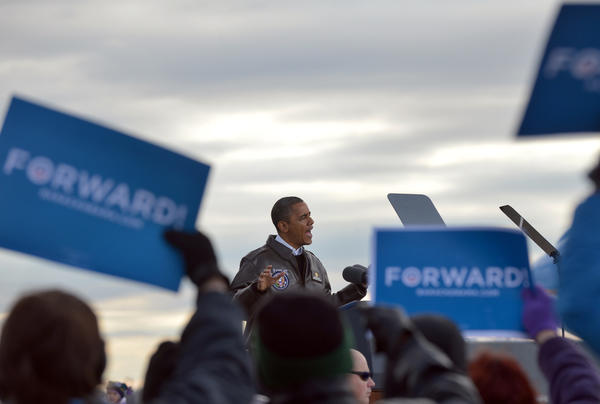 President Obama speaks during a campaign rally at Austin Straubel International Airport in Green Bay, Wis.