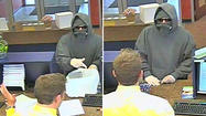 A hooded bandit wearing sunglasses and a ski mask robbed the Susquehanna Bank on York Road at 3:17pm on Halloween. The robber demanded a teller turn over all the money the teller had. The suspect then left the bank on foot, with about $3,000 cash. The suspect is described as a white male, who was wearing a gray hooded 'Carhart' sweathshirt and black sweatpants.