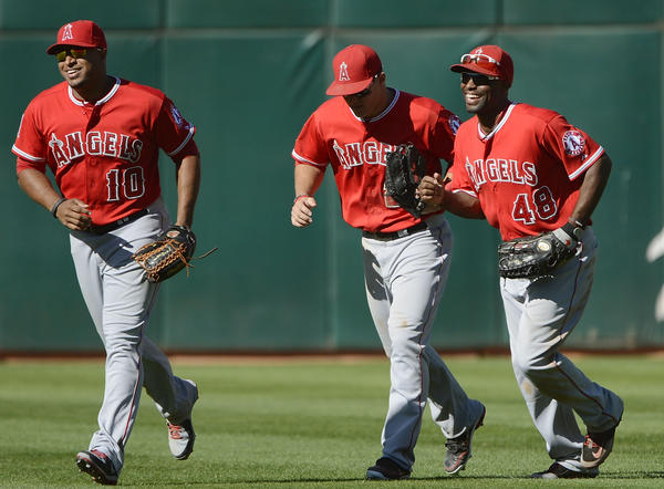 The outfield trio of Vernon Wells (10), Mike Trout and Torii Hunter (48) likely will not be together next season for the Angels.