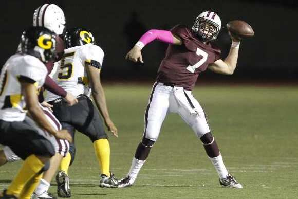 Laguna Beach High quarterback Larry Stewart threw for 217 yards and three touchdowns on nine of 13 passing in a 42-13 win over Godinez.