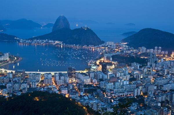 The night view of the Botafogo area shows Rio de Janeiro's Sugar Loaf mountain in background.