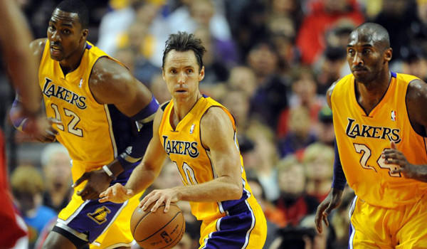 Lakers center Dwight Howard, guards Steve Nash and Kobe Bryant head up the court on a fast break against the Trail Blazers in the first quarter Wednesday.