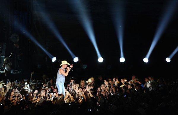 Kenny Chesney, seen during his Anaheim tour stop in July with Tim McGraw, is among the early winners for 2012 CMA Awards.