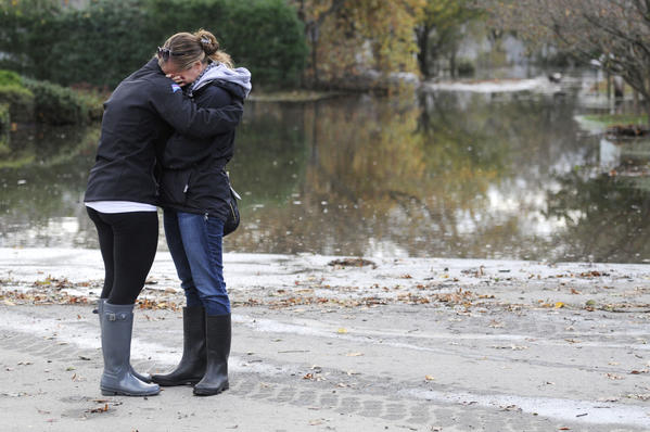 Residents of the Fairfield Beach section of Fairfield weep after seeing their neighborhood underwater. Blocks of houses were flooded after Hurricane Sandy pushed water into the neighborhood.