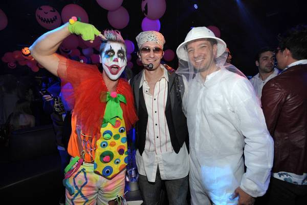 Lance Bass, left, as a clown, and a bee-keeping JC Chasez, right, hang with Matthew Morrison, dressed as the guys' real-life former band member Justin Timberlake.
