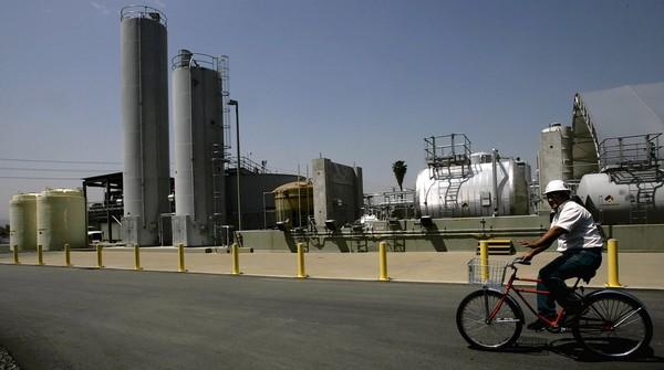 Edison International said its net profit fell to $190 million, or 58 cents a share, compared with $426 million, or $1.31, a year earlier. Sales rose 6.5% to $4.1 billion. Above, an employee rides around the company's generating facility in Redlands in 2006.