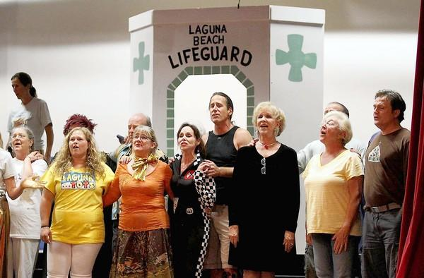 "Lagunatics cast members sing a dramatic version of ""Down in Laguna"" during a recent rehearsal of ""Shlock and Awe."""