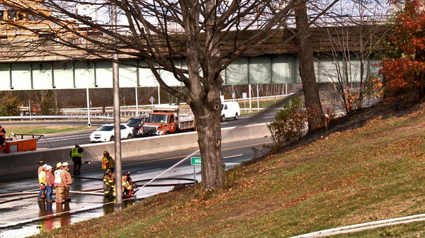 Milford fire fighters pour thousands of gallons of water on a natural gas leak underneath the High Street over pass to I-95 northbound. The highway was shutdown for several hours to make sure the leak was stopped and to check the condition of the bridge.