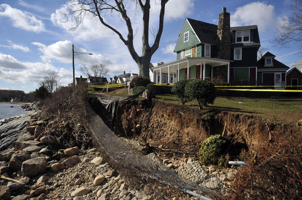 Part of a walkway near Cresent Beach in East Lyme lies in ruins after Hurricane Sandy slammed the state on Monday. Many shoreline communities are still without power and damage to property varied from town to town.