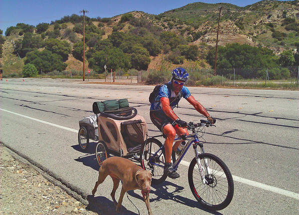 David Miller and his pal Max, a 6-year-old Weimaraner, are shown during their 'Bike50at50' excursion. Miller passed through the Eastern Panhandle of West Virginia on Thursday.
