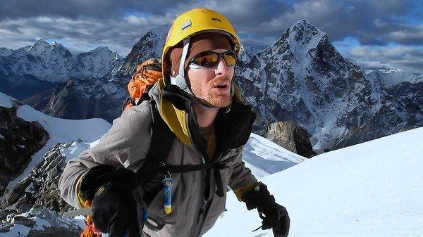 "Matt Nyman, just a few steps away from the summit of Mt. Lobuche in ""High Ground."""