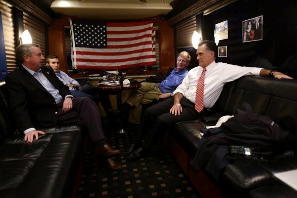 Republican Mitt Romney meets with advisors Ed Gillespie (from left), Kevin Madden and Stuart Stevens on his campaign bus.
