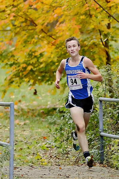 Boonsboro's Sean Snyder crosses a foot bridge on his way to the finish line and victory in the Maryland Class 1A West boys race at Smithsburg on Thursday.