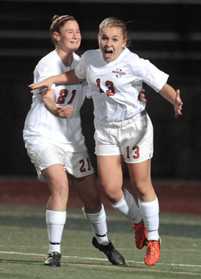Parkland #13 Kiera Kaunas and #21 Kayla Haberbosch celebrate the 1st goal scored by Kaunas in their  District 11 3A girls soccer semifinals against Nazareth held at J. Birney Crum Stadium on Thursday.