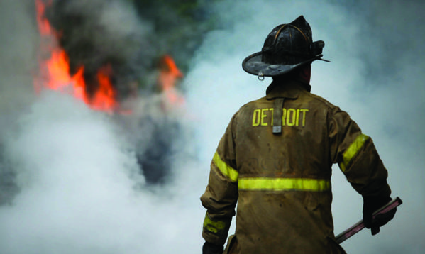 "A firefighter prepares to head into a fire in ""Burn."""