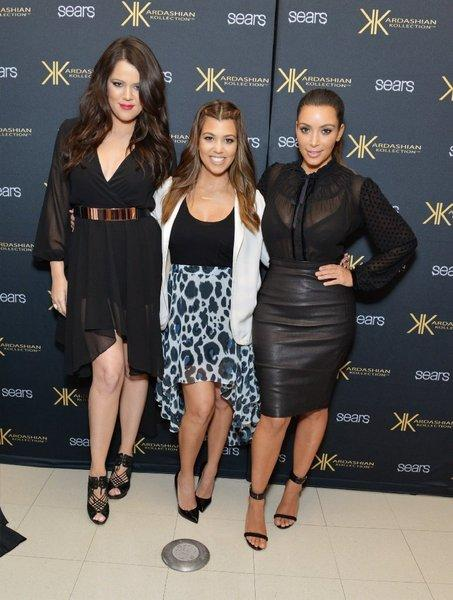 Khloe, left, Kourtney and Kim Kardashian at an event promoting their Kardashian Kollection clothing line for Sears in September. A Beverly Hills makeup studio is objecting to the name of the sisters' new cosmetics line.