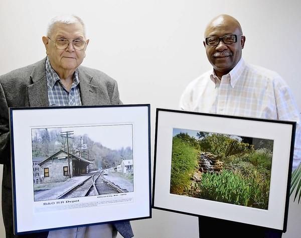 Photographers Don Reichle, left, and Joseph Murray have been shooting photos of Howard County for decades. Some of their images are now on display at The Columbia Foundation offices.
