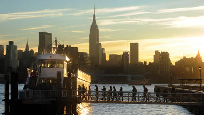 Commuters board a New York Waterway ferry bound for Midtown Manhattan at the 14th Street pier Thursday in Hoboken, N.J. New York City moved closer to resuming its frenetic pace by getting back its vital subways Thursday, three days after a superstorm, but neighboring New Jersey was stunned by coastal devastation and the news of thousands of people in one city still stranded by increasingly fetid floodwaters.