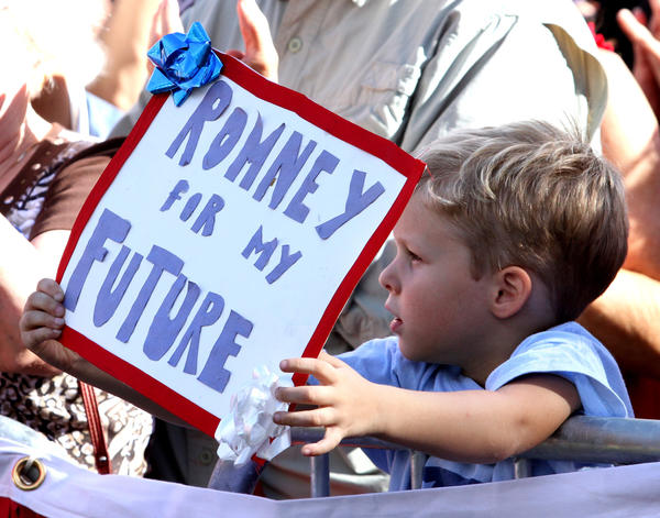 A young supporter holds a sign waiting for Ann Romney during a rally for her husband, Republican presidential nominee Mitt Romney, in Winter Park, Fla., Wednesday, October 24, 2012.