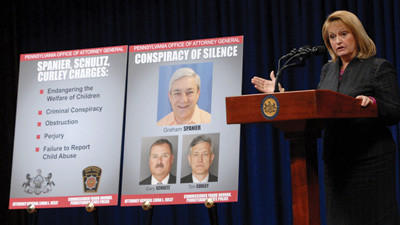 Pennsylvania Attorney General Linda Kelly announces new criminal charges related to an ongoing child sex crimes investigation against former Penn State President Graham Spanier and added charges against two former underlings, Timothy Curley and Gary Schultz during a news conference Thursday at the state capitol in Harrisburg, Pa. Spanier was charged with perjury, obstruction, endangering the welfare of children, failure to properly report suspected abuse and conspiracy. Curley and Schultz face new charges of endangering the welfare of children, obstruction and conspiracy.
