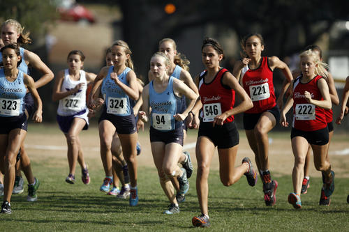Runners sprint at the start line during a meet at Crescenta Valley Park on Thursday, November 1, 2012.