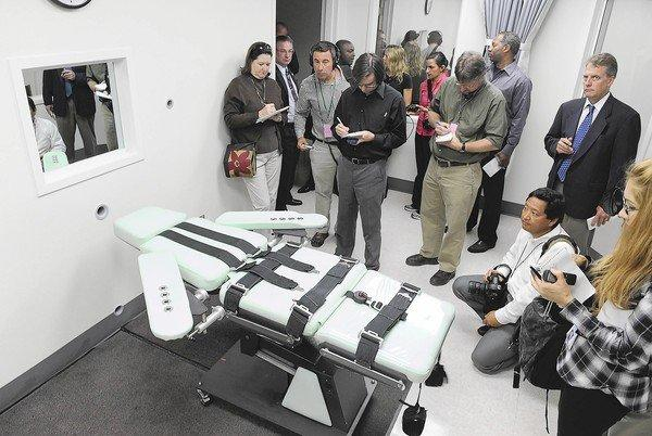 Members of the media get a look inside the lethal injection chamber at San Quentin State Prison.