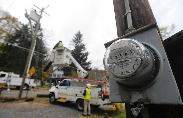 A meter is idle as a utility crew from Progress Energy from Raleigh, N.C., work on utility poles that are down due to Hurricane Sandy along Rt. 611 North., at Jay R. Snyder Memorial Park at Eddyside Beach in Easton.