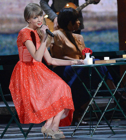 Country Music Association Awards 2012: Best and worst moments: Taylor Swift may be growing up, but her idea of love is still as cliched as ever! Her performance of Begin Again featured kitten heels, the Eiffel Tower lit up at night, red lipstick, a quaint cafe, and softly falling fake snow. Luckily, her performance was immediately followed by that song about motorboating, so our bubble was burst pretty quickly.  -- Carina Adly MacKenzie, Zap2it