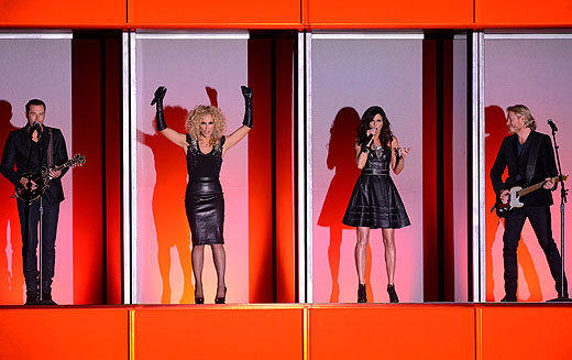 "The country music world is no stranger to big hair, but Little Big Town paid homage to the '80s in another way during their 2012 CMA Awards performance, singing the entirety of ""Pontoon"" in what appeared to be the set of a lost Robert Palmer video. All four band members lined up in separate little cubbyholes on stage, writhing around sexily in black leather while they sang their ode to the leisurely pastime of motorboatin' and the stage around them displayed cheese-tastic graphics. Does anyone else suddenly have the urge to day drink while sailing on a pontoon boat? <br><br> <i>-- <a href=""http://twitter.com/hijean"">Jean Bentley</a>, <a>href=""http://www.zap2it.com"">Zap2it</a></i>"