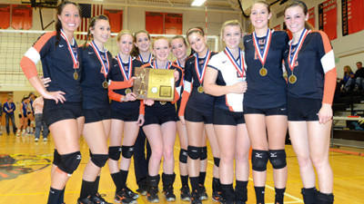 Somerset seniors hold the District 5 Class AA volleyball championship trophy after defeating Bedford on Thursday. See more images by visiting the photo galleries at dailyamerican.com.