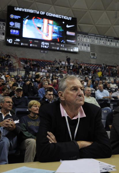 Former UConn head coach Jim Calhoun watches UConn with Kevin Ollie; it was Ollie's first game as UConn head coach.
