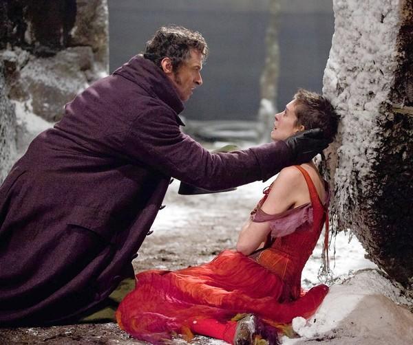 "Hugh Jackman and Anne Hathaway portray Jean Valjean and Fantine, respectively, in director Tom Hooper's film version of the musical ""Les Misérables."""