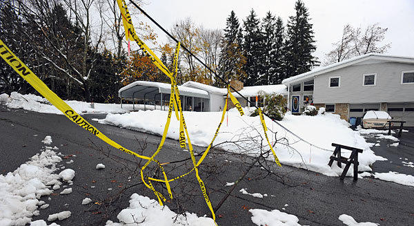 Downed wires block a street in Oakland, Md. Garrett County is still struggling to recover after Sandy dumped over two feet of snow in the area, causing massive power outages.