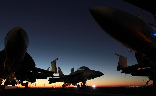 On the deck of the USS Enterprise F-18s are lashed to the deck as the 51-year-old ship prepares to make its final voyage home to Norfolk from Naval Station Mayport Friday morning, Nov 2, 2012.