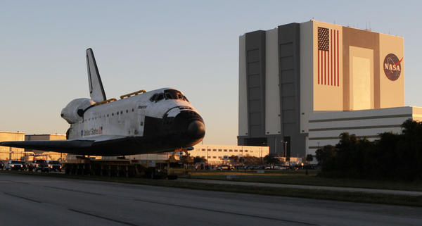 Space Shuttle Atlantis leaves the Vehicle Assembly building behind Friday, November 2, 2012 on a slow trek to it's new home at Kennedy Space Center Visitors Complex.