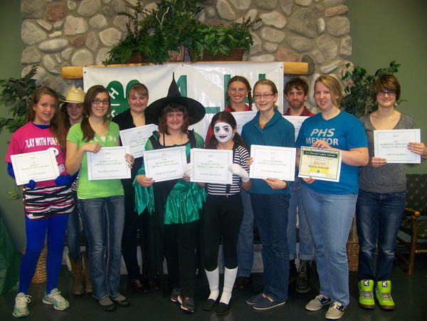 These Emmet County 4-H members received award certificates and national project pins for their accomplishments in 4-H this past year: (back, from left) Kortney Heckman, Lily Gregory, Carrie Coy and Nickolas Willcome; (front) Lauren Bixby, Rachel Armock, Makayla Smith, Nicole Heckman, Shannon Brown and Oryonah Ross.