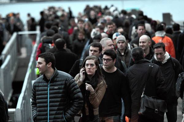 Photos: Hurricane Sandy: Commuters board a ferry to go to Manhattan from Paulus Hook Pier at Exchange Place in New Jersey.
