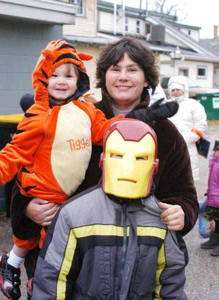 Megan Wilson, of East Jordan, brought her sons, Conner (Tigger) and Daniel (Iron Man), to march in the Boyne City Halloween parade Wednesday and then participate in downtown trick or treating afterward.