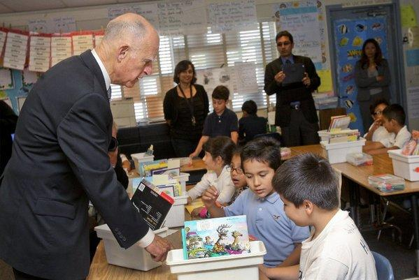 Gov. Jerry Brown talks with second-graders at Perkins Elementary School in San Diego last month.