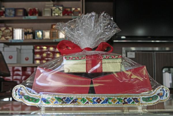 Gift boxes of sweets are packaged for Diwali at Surati Farsan Mart restaurant in Artesia, CA.