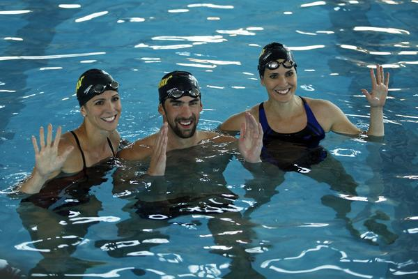 No, a swimming portion has not been added to the New York City Marathon, However, Whitney (left), Michael and Hilary Phelps did get in the pool last month as a promotion for Whitney's participation in the marathon.