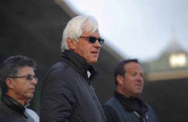 Trainer Bob Baffert watches his horses train on Wednesday in preparation for the Breeders' Cup this weekend at Santa Anita Park.